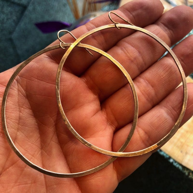 claire van holthe large silver hoop earrings in hand - ancienne ambiance