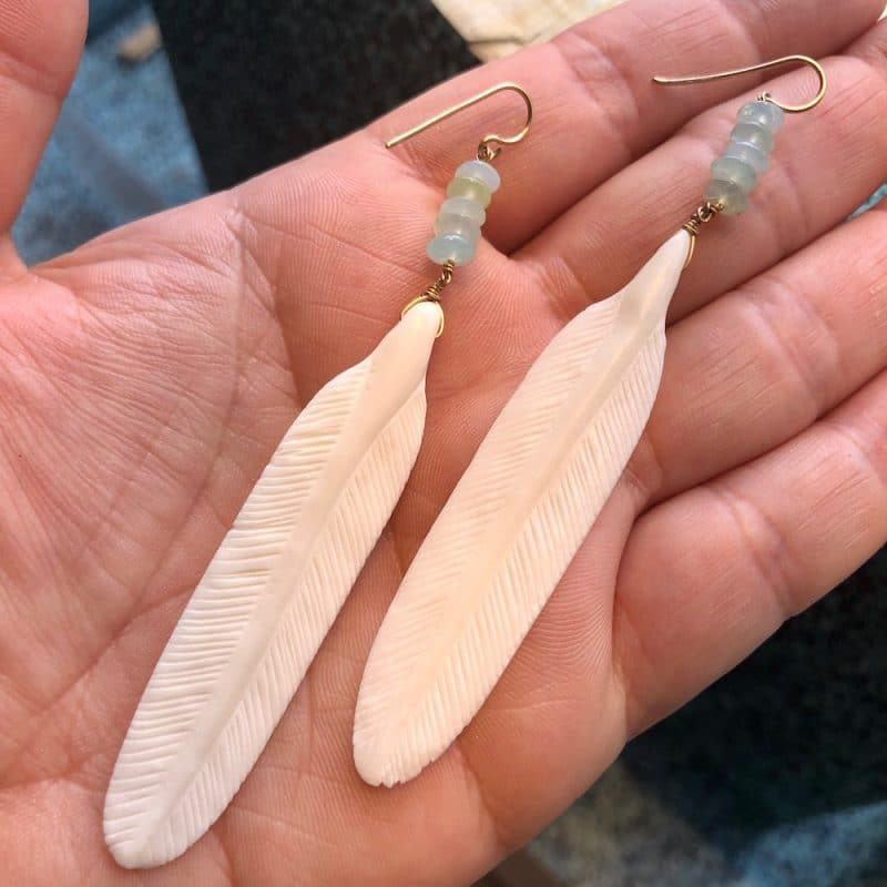 claire van holthe opal feather earrings in hand - ancienne ambiance