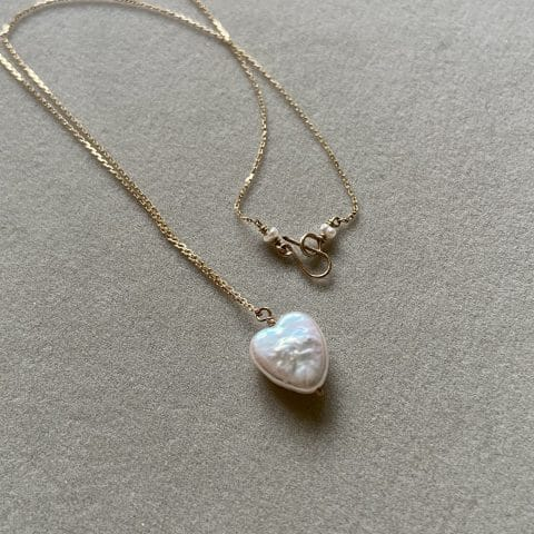ancienne ambiance - claire van holthe pearl heart necklace 9k gold chain